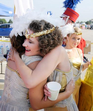 Elwood guard members Jessy Brown and Janene Kleyk hug following their performance.