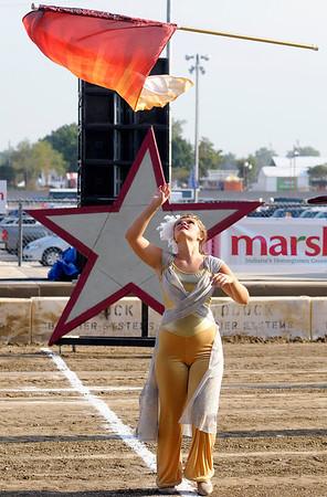 Elwood guard member Janene Kleyla tosses a flag into the air.