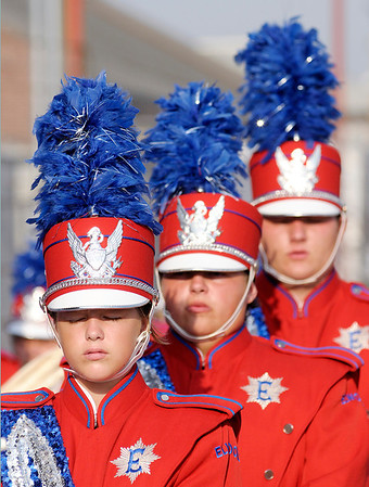The band mentally prepares in the moments before their performance.