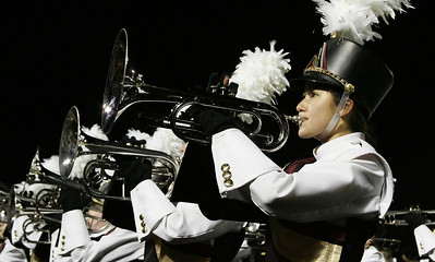 Rebecca Plow plays trumpet in the Avon Lake high school marching band at Band-O-Rama Saturday night. photo by Ray Riedel