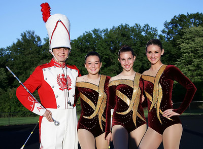 Avon Lake Drum Major Kellen Henry poses with Meredith Klopp, Mackenzie Miller, and Anelise Kollias before Band-O-Rama Saturday night. photo by Ray Riedel