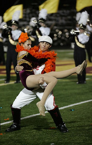 Mackenzie Miller leaps into the arms of Drum Major Kellen Henry in front of the Avon Lake marching band. photo by Ray Riedel