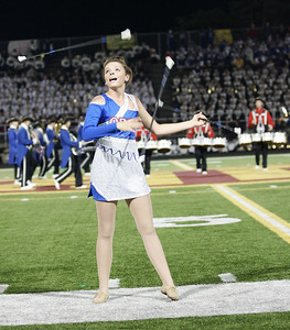 Majorette Macie Ludwig performs with the Open Door Marching band at Band-O-Rama. photo by Ray Riedel