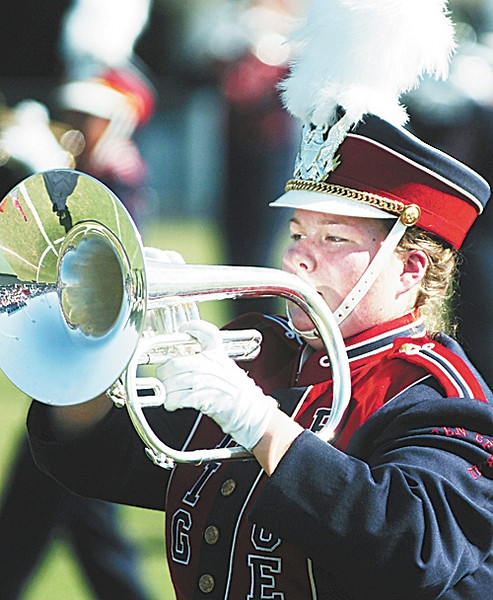 """Ashley Walker, 16, and the rest of Warren Central's """"Big Blue"""" band perform the program """"Synergy"""" during the Red Carpet Invitational Band Contest Saturday. The contest was hosted by the Vicksburg High PRIDE band and held at Warren Central's Viking Stadium. Ashley's parents are Carolyn and Robert Walker."""