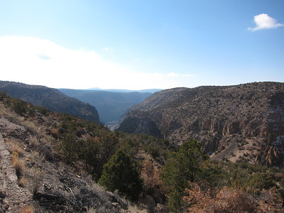 View to the south from the top of the canyon overlooking Bandelier with the Rio Grande barely visible.