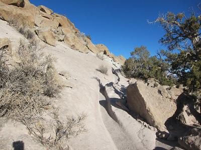 Original trail worn into volcanic tuff.