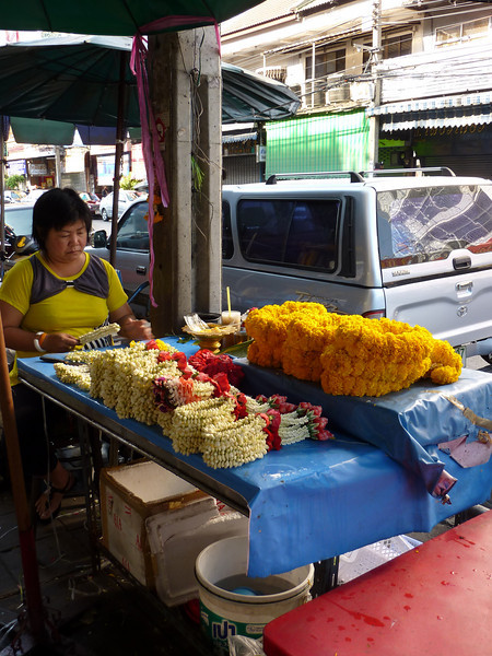 Woman making the floral offerings, Chinatown, Bangkok