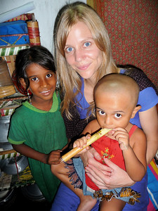 kate, rohan and a neighbor on kate's goodbye visit to rokhia's family