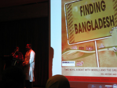 "samdani and his wife speaking at the westin ballroom for the premiere of their son's documentary ""finding bangladesh"""