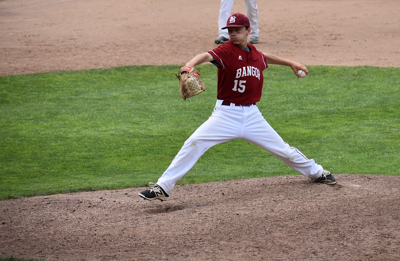 Carson Prouty of Bangor High School delivers a pitch during Saturday's Class A baseball state title game against Gorham at Saint Joseph's College in Standish. The poised sophomore pitched 2 2/3 scoreless innings to help Bangor close out its fifth consecutive state championship.