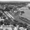 View of Bangor from lower Main Street showing the two bridges to Brewer  (Penobscot Bridge and Joshua Chamberlain Bridge) at top right. BANGOR DAILY NEWS PHOTO BY SPIKE WEBB<br /> <br /> Note: This aerial photograph was taken by NEWS photographer Spike Webb sometime in the late 1950's to very early 1960's...the Chamberlain Bridge was built in the mid-'50s and Union Station was razed in late 1961, but is clearly visible in this photograph.
