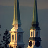 IN-SPIRED   The brick Union Street church (left) on Union and Main streets in Bangor, formerly the Unitarian church and the Hammond Street Congregational Church are visually compressed in this photo taken more than a mile away from the churches, in Brewer. The foreshortening effect of a telephoto lens makes the churches appear much closer together than they really are. (NEWS Photo by Bob DeLong)