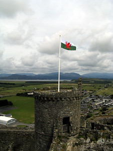 The flag of Wales flies from the castle.  Harlech castle was originally built as part of King Edward I's effort to conquer Wales.