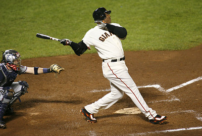 Barry Bonds connects for his record-setting 756th homerun, a fifth inning solo shot, at AT&T Park against Washington Nationals pitcher Mike Bacsik in San Francisco, CA, on 8/7/07.  Reuters/Dino Vournas
