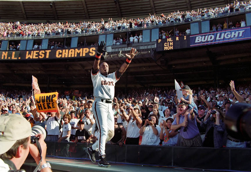 Barry Bonds celebrates the San Francisco Giants victory to clinch the National League West title in 1997.<br /> Oakland Tribune/Dino Vournas