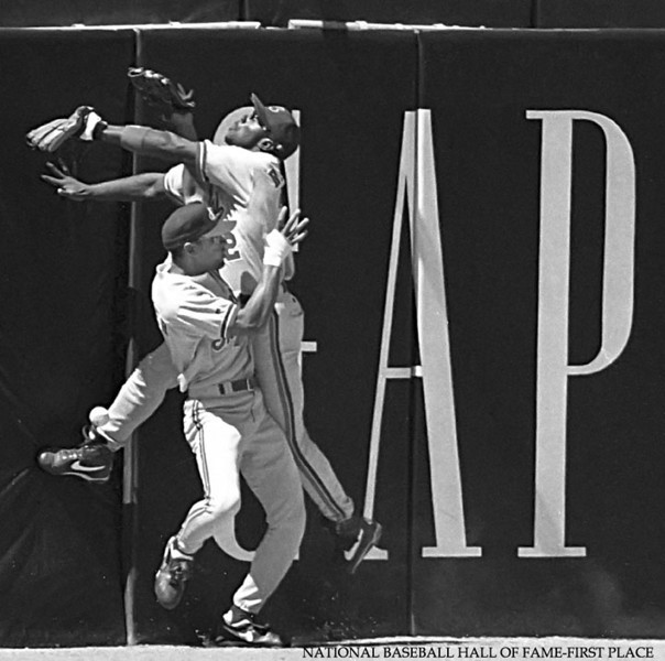 Montreal Expos outfielders Lou Frazier, bottom,  and Rondell White collide trying to catch a fly ball at the wall against the San Francisco Giants.  Hayward Daily Review/Dino Vournas