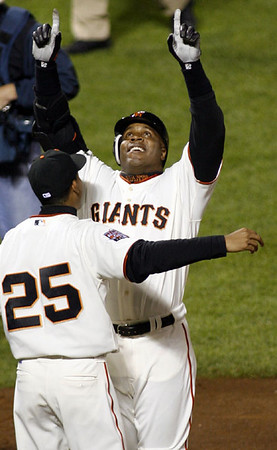Barry Bonds celebrates at home with his son Nikolai after hitting his record 756th home run at AT&T Park, San Francisco, August 7, 2007.  Reuters/Dino Vournas