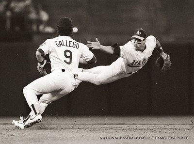 A's shortstop Walt Weiss relays a throw to 2B-Mike Gallego to start a double play in the American League Championship Series.  Hayward Daily Review/Dino Vournas