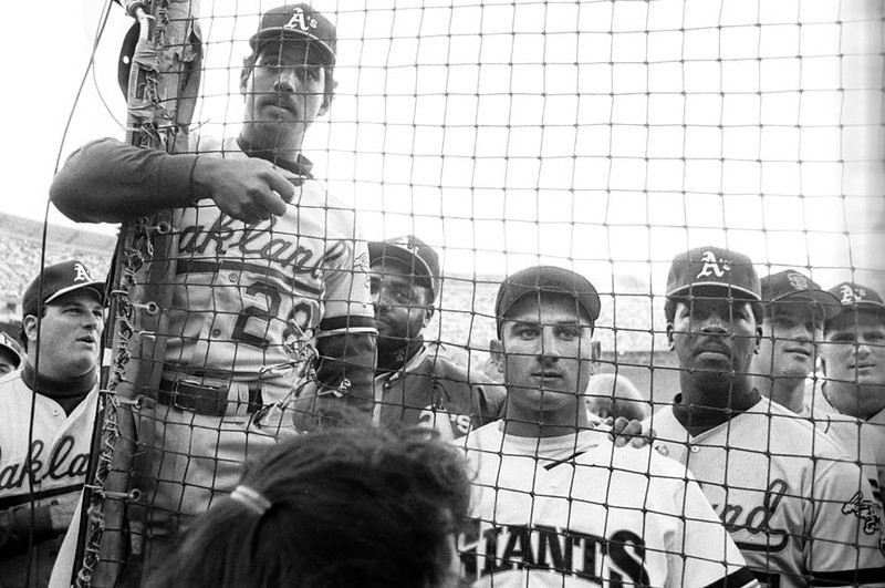 Giants and A's players check a TV monitor for news just after the Loma Prieta earthquake struck at Candlestick Park during game 3 of the 1989 World Series on October 17.  Hayward Daily Review/Dino Vournas