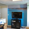 TV wall after we hung up the photo mural.