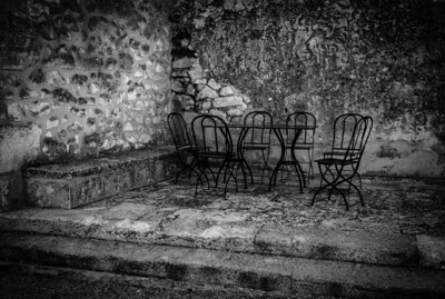 Steel table and chair set, near the cemetery in the village of Baux de Provence, France