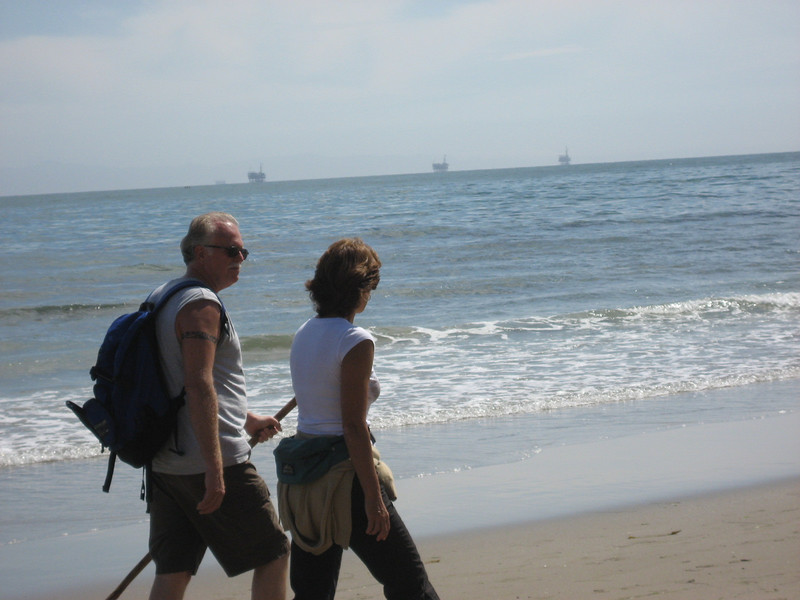 Bill deSilva and Ann Wright chat as they walk the coast line.