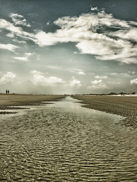 Puddles and rippled eddies left by Beryl who stirred the waters and shifted the sands. A beach washed clean.