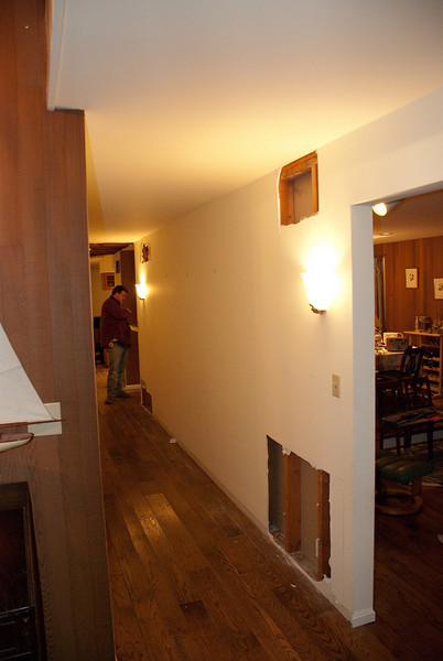 The hallway was a river, and we had a few test holes in the wall - yup, they were wet too.