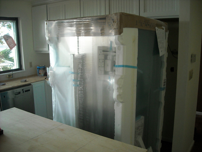 Big new fridge almost ready to slide in.