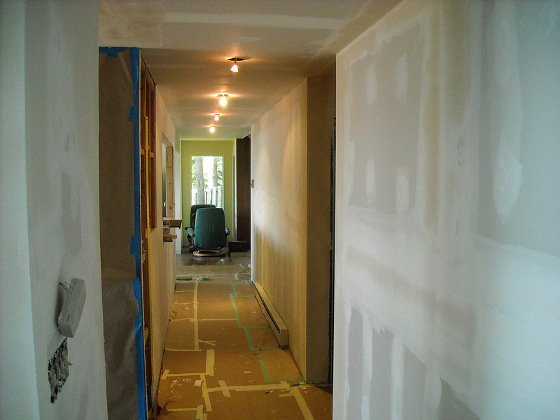 Plasterboard up and taped.  This is about how Susan first saw it (although I took up the craft paper protecting the floor).