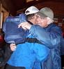 Lots of hugs as friends gather in the registration cabin.
