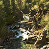 In many other sections, confined to a steep gorge, it is a tumbling cascade of white water over huge granite boulders.