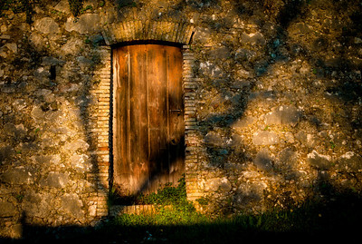 Old wooden door in Saint-Paul, France, French Riviera.