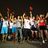 Chinese citizens cheer for the home team.