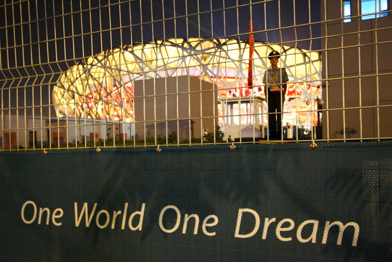 The National Stadium, also known as the Bird's Nest, and the Beijing Olympic slogan. The Olympic Green, where it is located, is off limits to the public.