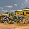 Sign at the main intersection in Hopkins, Belize.  Painted by Juan Kantor.