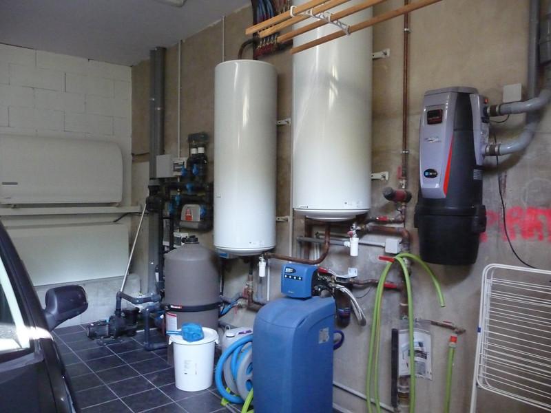 Right Hand Garage pool equipment & water tanks