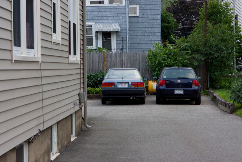 Our cars in our driveway.  Note mine has Mass plates already, but Abby's does not.