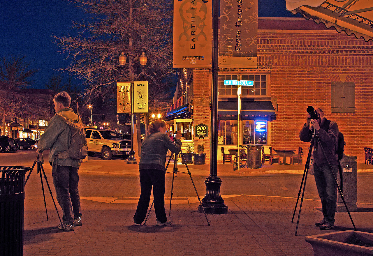 Students from the Cascade Center for Photography at a downtown night shoot in downtown Bend.