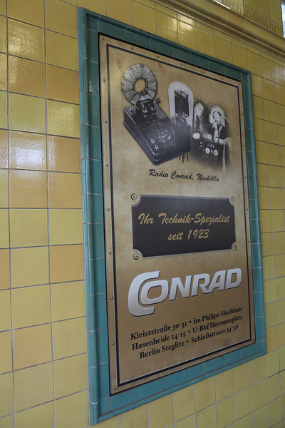 A real OLD billboard from CONRAD, at the oldest metrostation of Perlin (Pankov), jawohl!!<br /> On the next picture in this gallery, you'll see the current logo of CONRAD, still the same but yellow-blue colored...