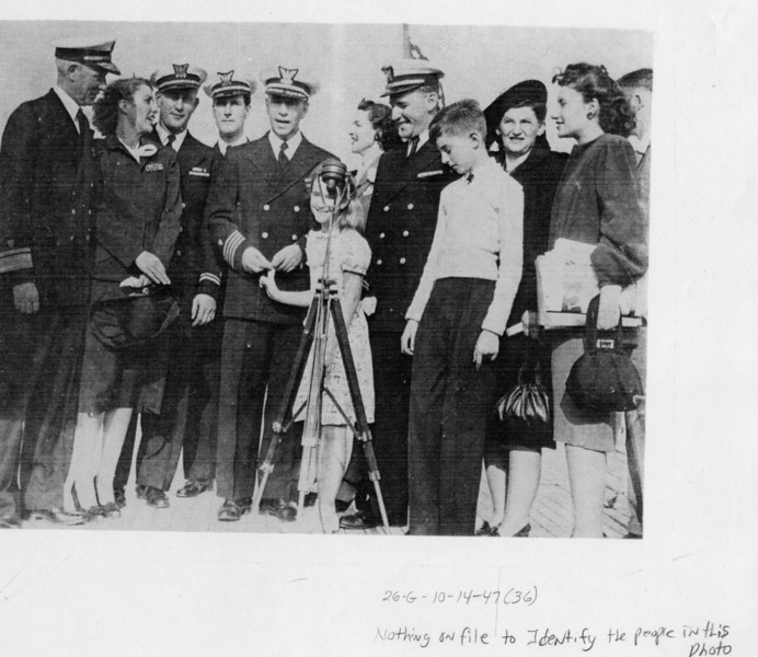 We have recently learned the names of some of the people in this photo.  The man holding the girl's hand is Capt. Paul B. Cronk; the girl is his daughter, Nan (Cronk) Vance; the woman just behind him is his wife, Lois Cronk (still living in Massachusetts); the skinny boy in front is Capt P.B. Cronk's son, Capt. Peter Cronk, USCG Ret. Thanks to Jon Cronk, who is the son of Peter Cronk, pictured above, for bringing this information to our attention. (12/2008)
