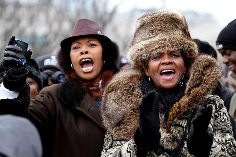 January 21, 2013 - Wonda Lewis (left) and Alesia Lewis-Dupree (right), both of Jonesboro, Georgia cheer alongside Constitution Avenue in Washington, D.C. as they observe the swearing-in ceremony for President Barack Obama on the day of the 57th Presidential Inauguration. Photo by Billie Weiss.