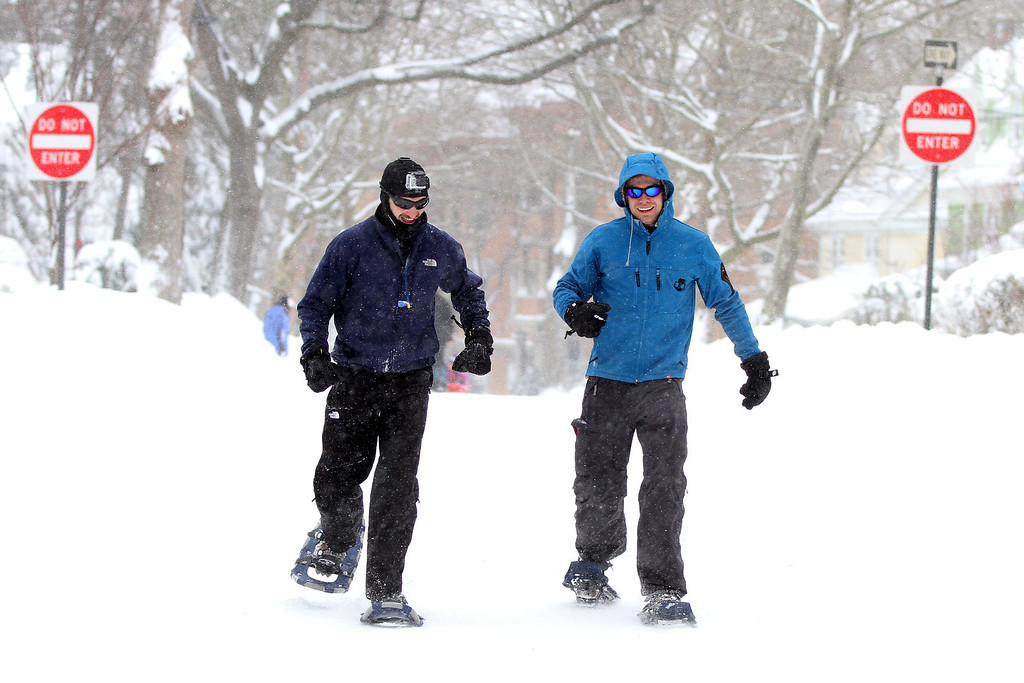 Feb. 9, 2013 - Thomas Battey (left) and Vincent Valant (right), both residents of Brookline, Massachusetts walk with snowshoes down Fuller Street after a winter storm passed through the Northeast, leaving over 20 inches of snow in the city of Boston. Photo by Billie Weiss.