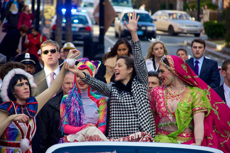 Jan. 31, 2013 – Actress Marion Cotillard, center, successfully captures a pom-pom presented by Hasty Pudding member Phil Gillen, left, during the Hasty Pudding Theatrical Society's 2013 Woman of the Year award parade held annually by Harvard University in Cambridge MA. The parade was preceded by a roast of Cotillard by Pudding President Renée Rober, center left, and Cast Vice President Ben Moss, right. Photo by Hillary Larson.