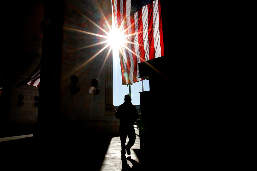 January 20, 2012 - The sun rises as a pedestrian passes by the entrance of Union Station in Washington, D.C. on the day before the 57th Presidential Inauguration. Photo by Billie Weiss.