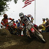 I like how the flags works with the red, white, and blue gear worn by Tommy Hahn under the famous Unadilla tree turn.