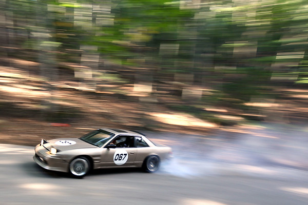 Christian Leone, driving a 1989 Nissan 240sx, skids around a turn as he powers up Wilco Road in Empire for the Empire Hill Climb on Saturday, Sept. 24, 2016.