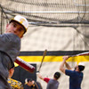 Traverse City Central baseball players Logan Briggs, left, and Jake Tolfree, right, practice in the gym at Traverse City Central High School with teammates while winter weather prevents spring sports from practicing outside on Wednesday, April 6, 2016.