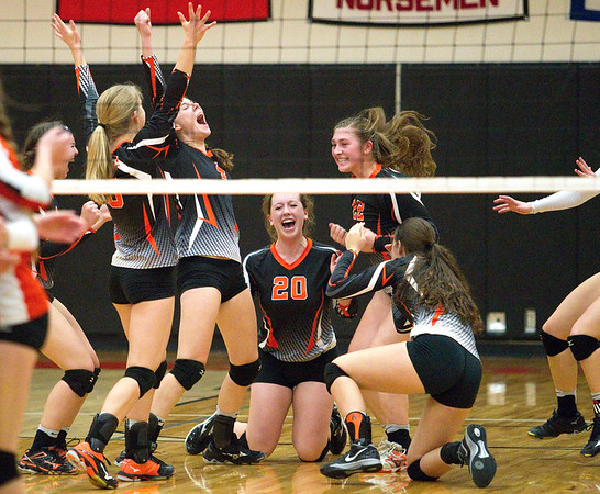 The Kingsley girls volleyball team celebrates winning their set against Cheboygan High School at Kingsley on Thursday, November 3, 2016. The Stags won 3-0 to take home the district championship trophy.