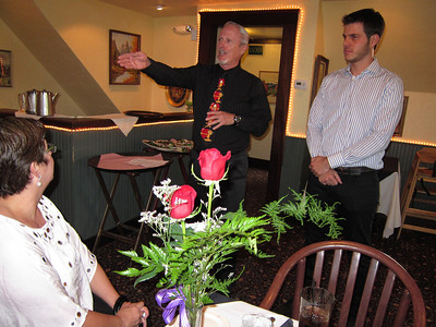 At dinner: Richard, Kelly's dad, has something to say, with help of Portuguese interpreter, Andre.